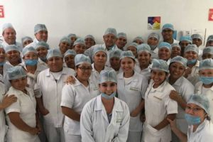 López Obrador, in center at back, with staff at Agromod in Chiapas.