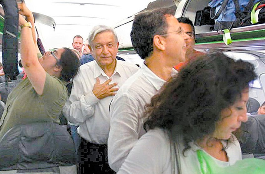AMLO aboard his commercial flight from Huatulco to Mexico City last night.