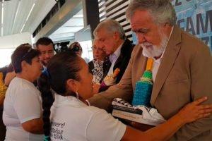 López Obrador, center, and Encinas with students' families today.