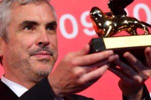 Cuarón and his Venice Film Festival award.