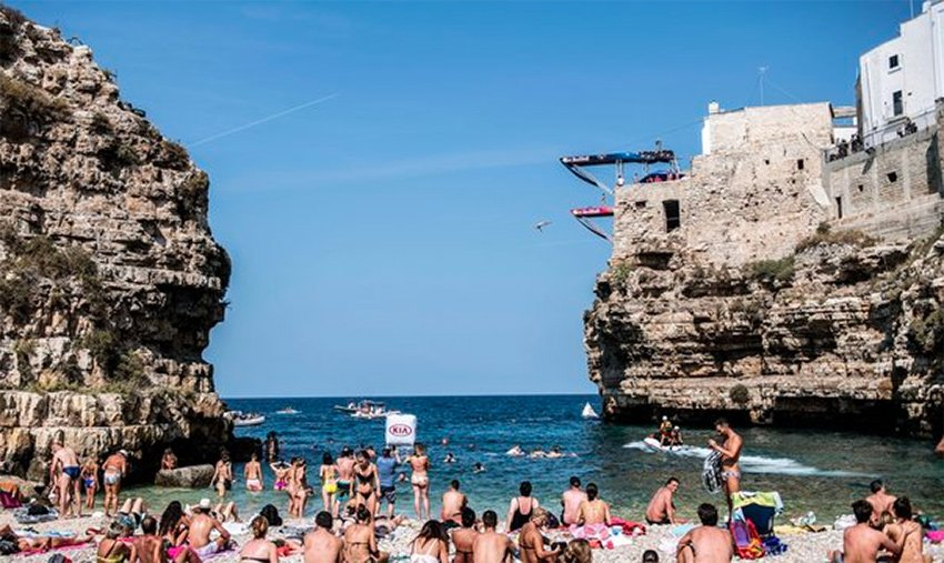 A diver leaves one of the two platforms in Polignano a Mare.