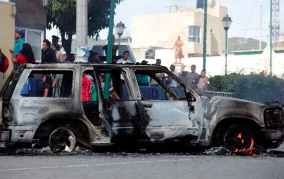 Lynch mob also burned the vehicle in which the two victims had been traveling.