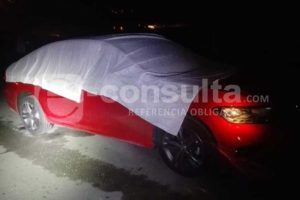 Victim's car was covered in a tarp to prevent photos.