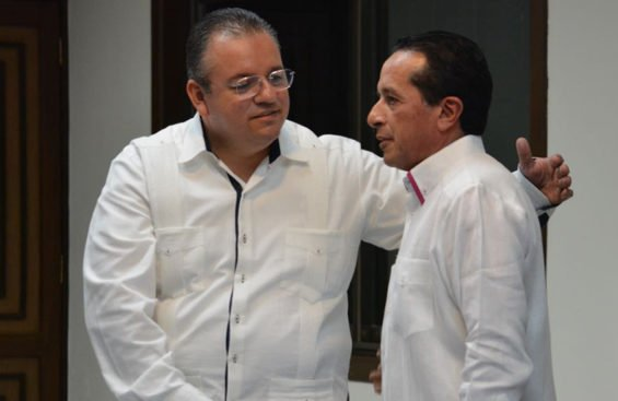 Capella, left, and Governor González.