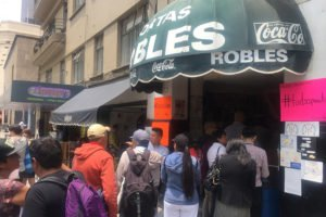 Supporters line up for a free torta at Mexico City's Tortas Robles.