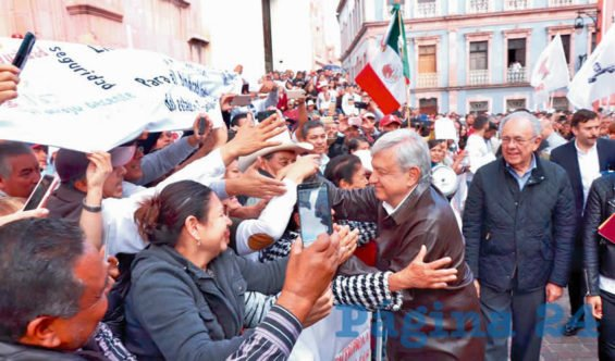 AMLO's fans give him a warm welcome to Zacatecas.