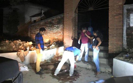 A sidewalk autopsy in Oaxaca.