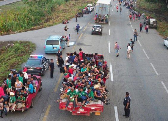 Travelers in caravan No. 1 hitching rides in Oaxaca.