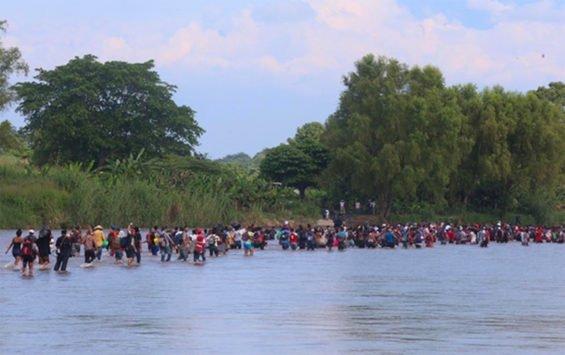 Central American migrants in the Suchiate river today.