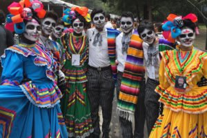 Participants wait for the start of Sunday's Day of the Dead parade in Mexico City.