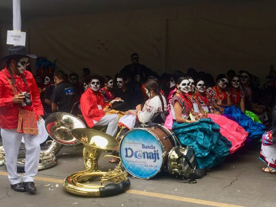 A brass band from Oaxaca awaits start of the parade.