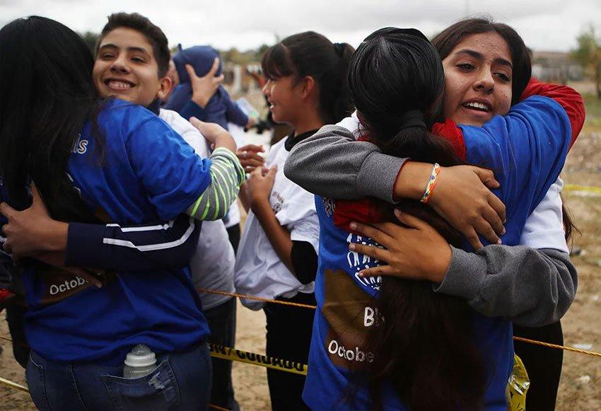 Hugs at the border.