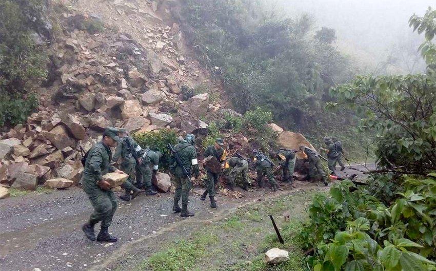 Soldiers clear a highway in Oaxaca.