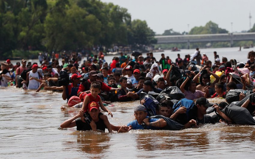 Migrants cross the river today between Guatemala and Mexico.