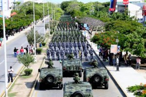 Military personnel march yesterday in Cancún to inaugurate new base.