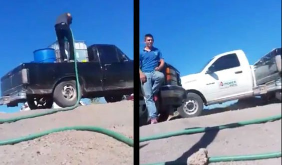 A Pemex truck drives past a pipeline theft in progress in a video shot earlier this year.