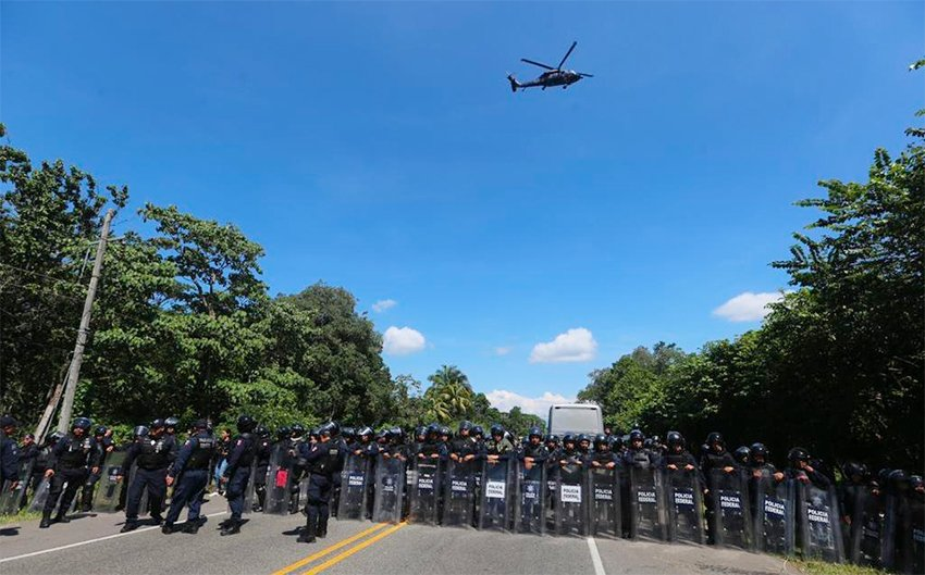Police form a barricade today in Chiapas, hoping to stop the migrant caravan.