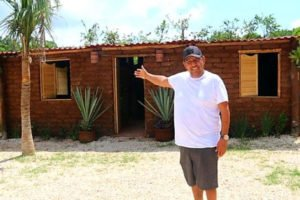 Omar Vázquez and his sargassum-adobe house.