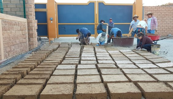Volunteers make adobe bricks with mezcal production waste.