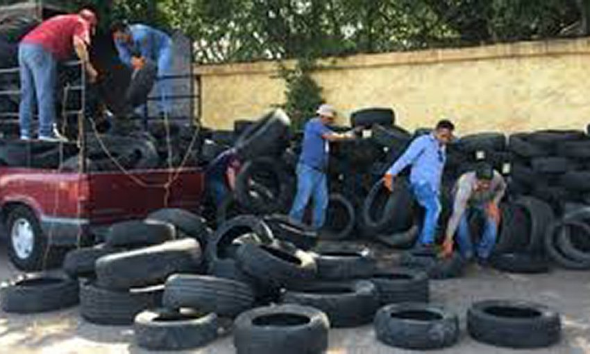 Collecting old tires in Cuernavaca.