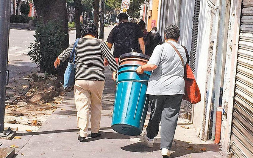 Mexico City residents stock up on water containers.