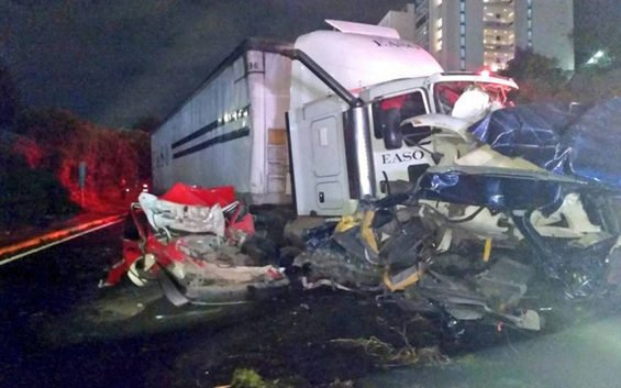 The semi amid crumpled cars after yesterday's accident.