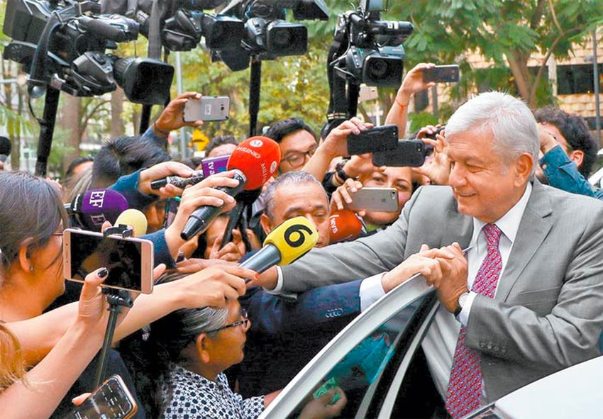 López Obrador greets fans after yesterday's airport meeting.