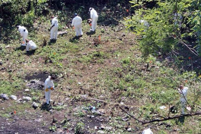 Investigators at the Cocula dump, where students' bodies might or might not have been burned.