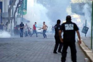 Protesters, police clash in Chiapas on Saturday.