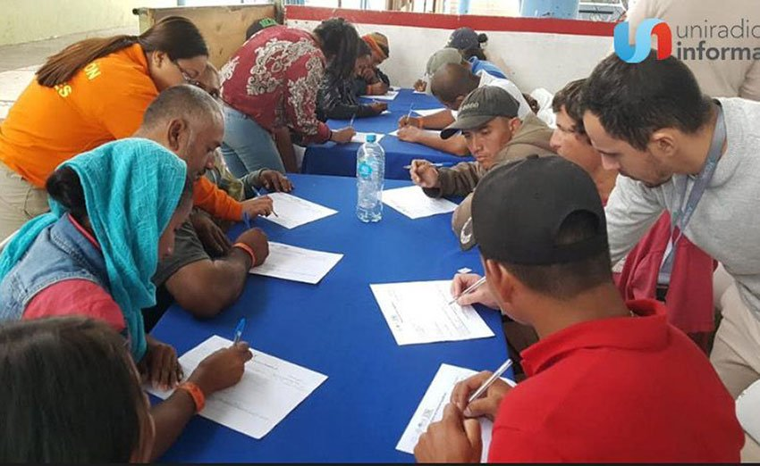 Central American migrants complete documents at Tijuana job fair.