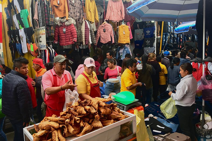 A chicharrones salesman works among thousands of vendors at the market in San Martín.