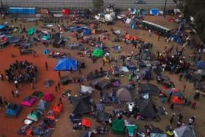 Migrants at the sports complex-shelter in Tijuana.