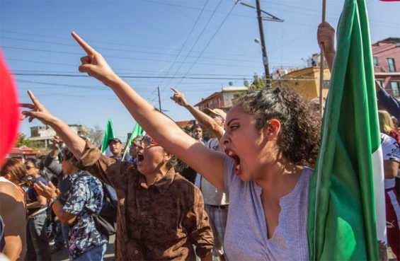 'Migrants out!' Tijuana protesters voice their disapproval over migrant arrivals.