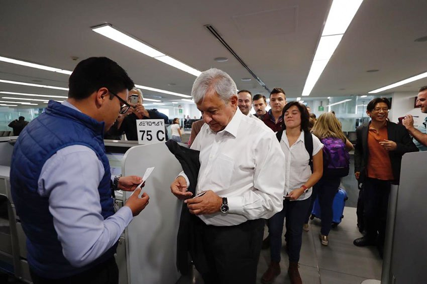 AMLO lines up at the gate to board his flight to Veracruz.
