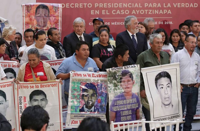 López Obrador with parents of the missing students during yesterday's signing of the decree.
