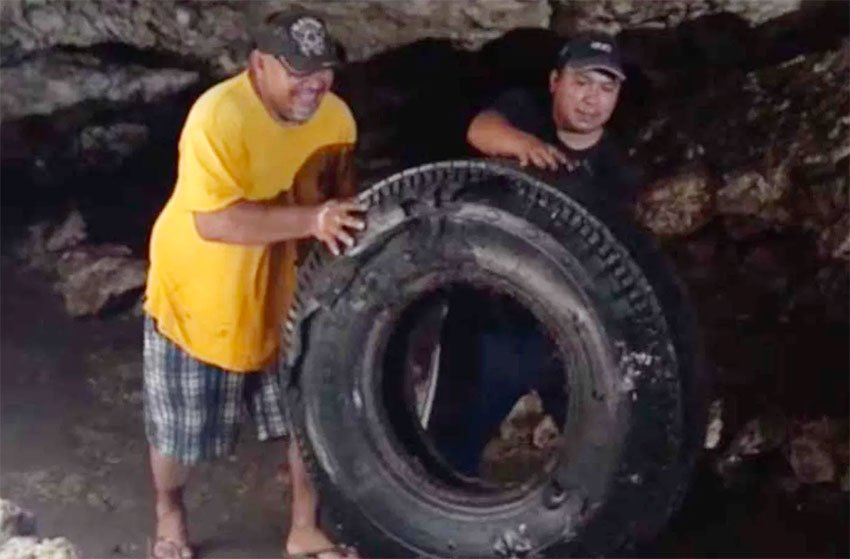 A tire is removed from a Yucatán cenote.
