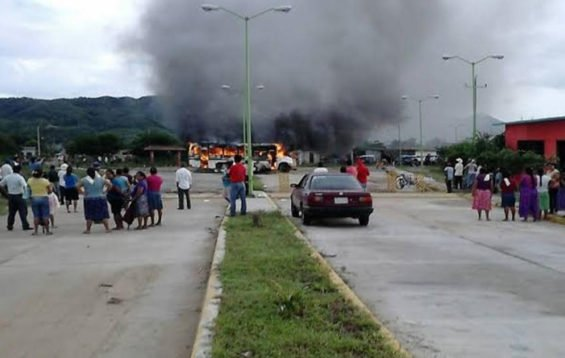 A bus burns during yesterday's election protest.