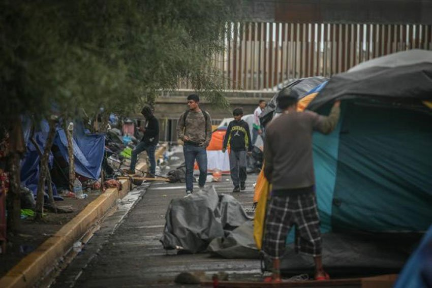 Migrants camping outside the Tijuana sports complex.