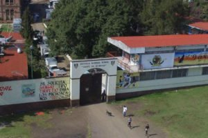 Hijacked trucks can be seen on the grounds of the Michoacán school.