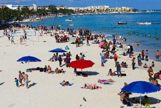 Tourists enjoy a Mexican beach.