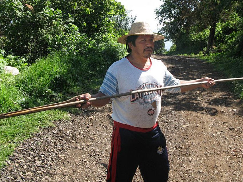 A fisherman shows how the atlatl was used to hunt ducks in Lake Pátzcuaro.