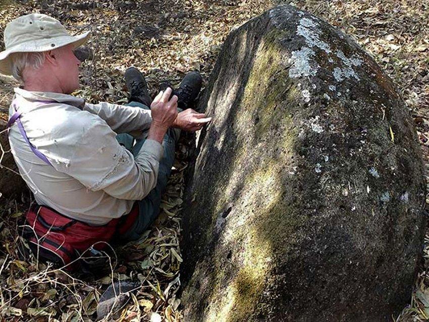 Examining the interior of a split stone ball