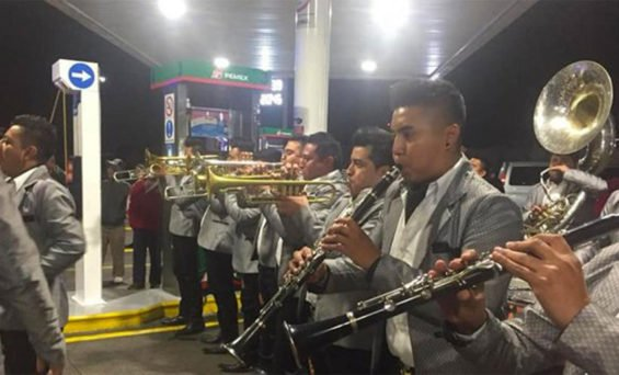 A brass band entertains motorists in Morelia early Wednesday morning.