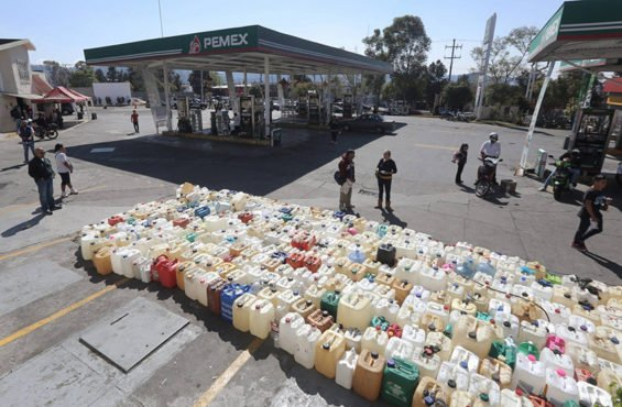 Hundreds of containers are lined up ready for the next shipment of gasoline to Morelia, Michoacán.