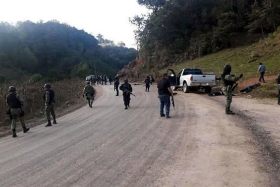 Security forces at the scene of yesterday's gunfight in Guerrero.