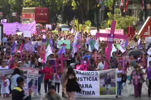 Marchers in Mexico City protest violence against women.