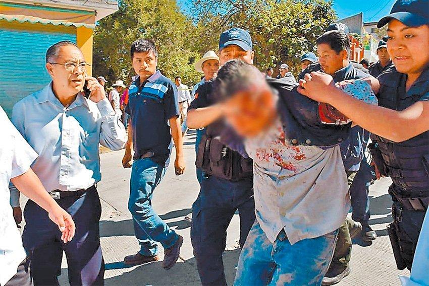 Police arrest a suspect in yesterday's murder.