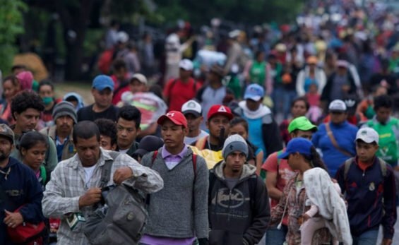 Migrants leave Mexico City this morning.