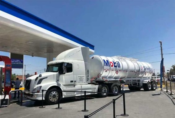 A Mobil tanker truck with a fuel delivery.