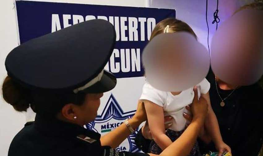 A police officer with the girl who had been taken from her mother.